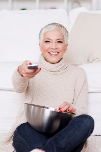 woman smiling with beautiful dentures thanks to the dental implants mankato loves