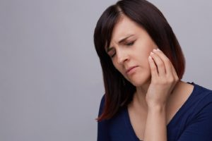 woman with jaw ache